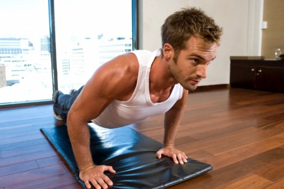 Man performing press-ups on mat